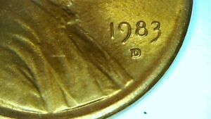1983D LINCOLN CENT MINT ERROR PENNY. RIM ERROR TOUCHES WORDS ON BOTH SIDES.
