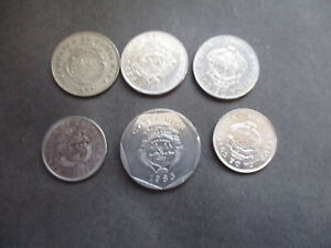 AN ASSORTMENT OF SEVEN [7] COSTA RICA COINS. LOT 13.