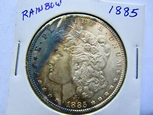 1885 $1 MORGAN SILVER DOLLAR UNCIRCULATED AND NICELY TONED WITH SOME RAINBOW