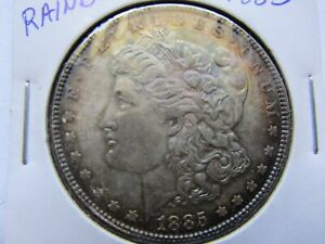 1885 $1 MORGAN SILVER DOLLAR UNCIRCULATED AND NICELY TONED W / SOME RAINBOW