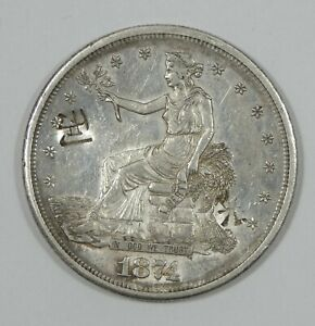 1874 S TRADE DOLLAR ALMOST UNCIRCULATED SILVER DOLLAR WITH CHOPMARKS