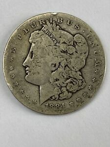 1884 S US $1 MORGAN SILVER DOLLAR ABOUT GOOD DETAILS