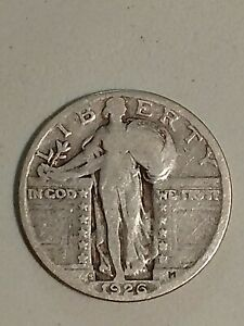 A SILVER STANDING LIBERTY QUARTER FROM 1926  S MINT