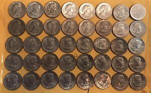 40 SUSAN B ANTHONY COINS INCLUDING A BLANK ERROR COIN