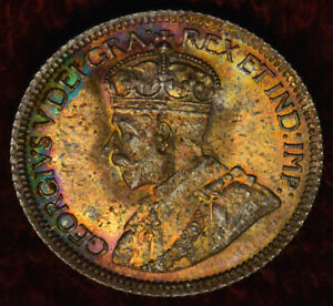 Click now to see the BUY IT NOW Price! 1934 10 ICCS MS 66 TOP 5 SUPERB GEM WITH DEEP AND INTENSE ORANGE GOLDS & BLUES