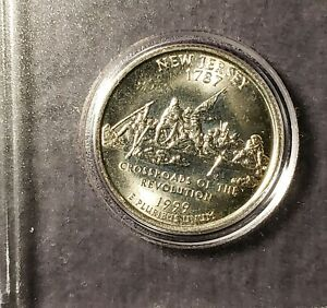 1999 P NEW JERSEY QUARTER WITH GOLD TONING  . FOUND IN BANK ROLL.