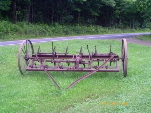 12 foot horse drawn cultivators/ garden sculpture/ rusty patina price reduced