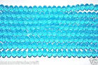 A string of faceted rondelle crystal glass beads 6x4mm  8x6mm  10x8 mm