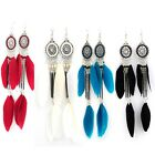 Hanging tribal earrings with beads and chains