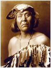 8196.Native american woman posing for picture.almost nude...
