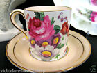 PARAGON TEA CUP AND SAUCER DEMI CAN PAINTED FLORAL CHINTZ ROSE PATTERN TEACUP
