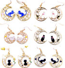 Enamel cat sitting on sparkly crescent moon earrings