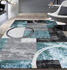 Ebern Designs Federico Abstract Circle Gray/Blue Area Rug