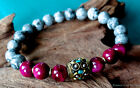 Picture gray jasper and pink tiger eye bracelet w/ Nepal turquoise bead