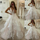 Beach Dream Wedding Dresses A Line V-Neck Backless Appliqued Lace Puffy Tulle