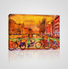 Rain over Amsterdam canal with Bicycle parked along Framed Canvas Print - YC11