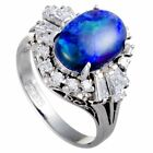 Platinum Round and Tapered Baguette Diamonds and Blue Opal Oval Ring