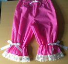 Bright pink bloomers with tiny white dots