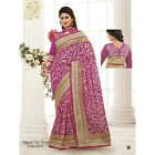 Triveni Tantalizing Magenta Colored Embroidered Net Saree