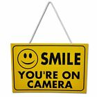Smile You're On Camera - Yellow Hanging Shop Work Sign