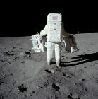 Buzz Aldrin carrying the EASEP out to the deployment site, Apollo 11