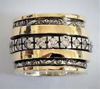 Meditation spinner ring for woman set with cz zircons