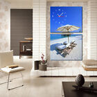 Chilling out by beautiful blue ocean High Quality Canvas Print framed wall clock
