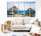 Huts on the rocks by blue sea Art photo On Quality Canvas Art Prints Set Of 5