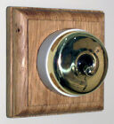 Plain Brass & Ceramic Dolly Switch Single Oak Pattress
