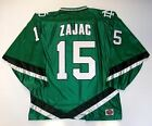 TRAVIS ZAJAC NORTH DAKOTA SIOUX GREEN JERSEY NEW JERSEY DEVILS