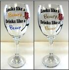 """Looks Like a Beauty, Drinks Like a Beast"" Wine Glass with Vinyl Wording and Red"