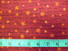 HENRY GLASS - SNOWBOUND - XMAS RHYMES ON DEEP RED & ORANGE COTTON FABRIC
