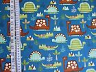 Dino-rific Dinasaurs on blue 100% cotton Fabric from Studie E