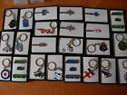 Assorted selection of boxed keyrings Tie clips and badge sets. FREE UK POSTAGE