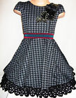 GIRLS 50s STYLE BLACK GREY DOGTOOTH PRINT ROSETTE TRIM SKATER PARTY DRESS