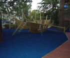 Children's soft play surface, rubber chippings, membrane and pegs for outdoor