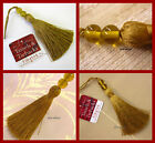 Gold key tassel with amber decorative glass beads