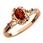 0.57 Ct Oval Red Garnet Blue Sapphire Rose Gold Plated Sterling Silver Ring