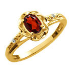 0.56 Ct Oval Red Garnet White Topaz Yellow Gold Plated Sterling Silver Ring