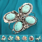 ST070-082 Turquoise Coloured Glaze Flower Butterfly Silver Plated Bangle